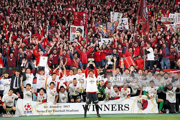 Captain Mitsuo Ogasawara of Kashima Antlers lifts the Emperor's Cup as players and supporters celebrate after the 96th Emperor's Cup final match...