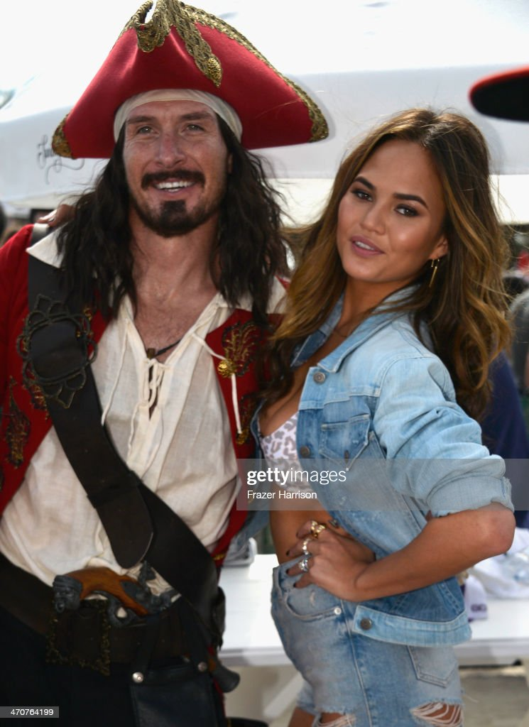 Captain Morgan and <a gi-track='captionPersonalityLinkClicked' href=/galleries/search?phrase=Christine+Teigen&family=editorial&specificpeople=4583768 ng-click='$event.stopPropagation()'>Christine Teigen</a> attends Sports Illustrated Swimsuit Beach Volleyball Tournament on Ocean Drive at Miami Beach on February 20, 2014 in Miami, Florida.