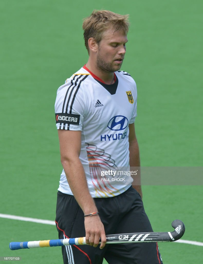 Captain Moritz Fuerste of Germany leaves the pitch after his team lost the first quarter final to Pakistan at the Men's Hockey Champions Trophy in Melbourne on December 6, 2012. Pakistan beat the number one 1 ranked Germany 2-1. IMAGE STRICTLY RESTRICTED TO EDITORIAL USE - STRICTLY NO COMMERCIAL USE AFP PHOTO/Paul CROCK