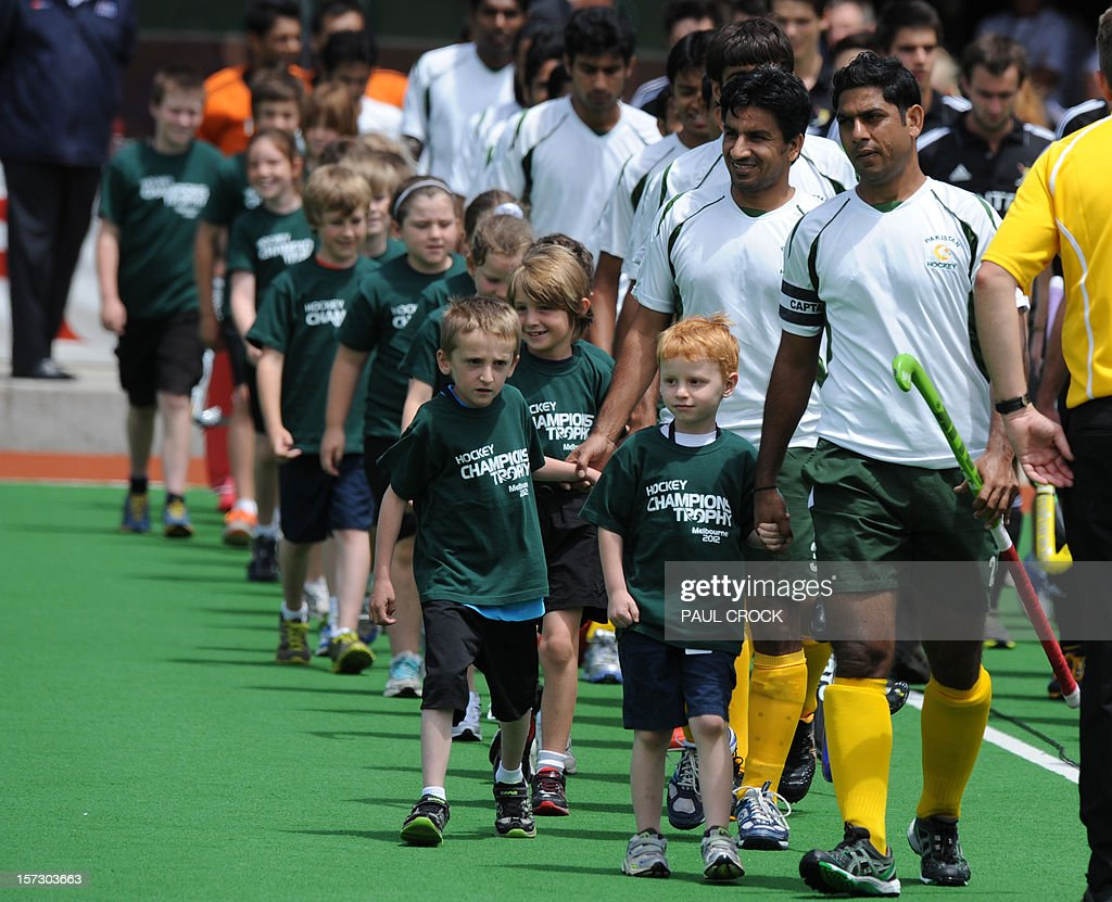 Captain Muhammad Imran of Pakistan (R) leads his team onto the pitch prior to their pool B match against Belgium at the Mens Hockey Champioships Trophy in Melbourne on December 2, 2012. Pakistan won the match 2-0. RESTRICTED TO EDITORIAL USE NO ADVERTISING USE NO PROMOTIONAL USE NO MERCHANDISING USE. AFP PHOTO/Paul CROCK