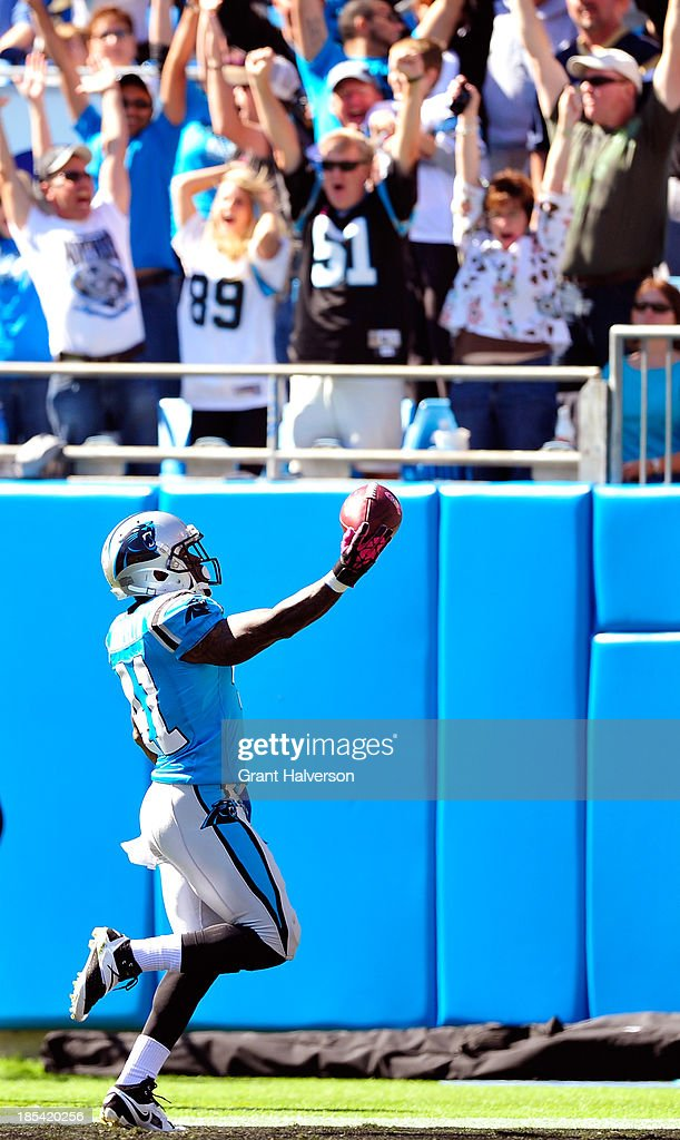 <a gi-track='captionPersonalityLinkClicked' href=/galleries/search?phrase=Captain+Munnerlyn&family=editorial&specificpeople=4063410 ng-click='$event.stopPropagation()'>Captain Munnerlyn</a> #41 of the Carolina Panthers returns an inteception for a touchdown on the frst play of the game against the St. Louis Rams at Bank of America Stadium on October 20, 2013 in Charlotte, North Carolina.