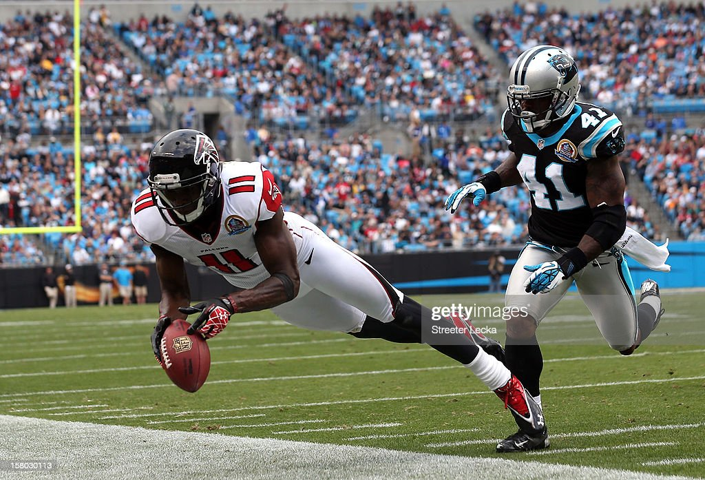 Captain Munnerlyn #41 of the Carolina Panthers watches as Julio Jones #11 of the Atlanta Falcons drops a pass during their game at Bank of America Stadium on December 9, 2012 in Charlotte, North Carolina.