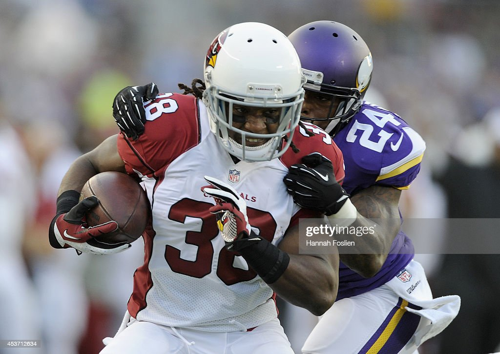 <a gi-track='captionPersonalityLinkClicked' href=/galleries/search?phrase=Captain+Munnerlyn&family=editorial&specificpeople=4063410 ng-click='$event.stopPropagation()'>Captain Munnerlyn</a> #24 of the Minnesota Vikings tackles <a gi-track='captionPersonalityLinkClicked' href=/galleries/search?phrase=Andre+Ellington&family=editorial&specificpeople=5519153 ng-click='$event.stopPropagation()'>Andre Ellington</a> #38 of the Arizona Cardinals during the first quarter of the preseason game on August 16, 2014 at TCF Bank Stadium in Minneapolis, Minnesota.