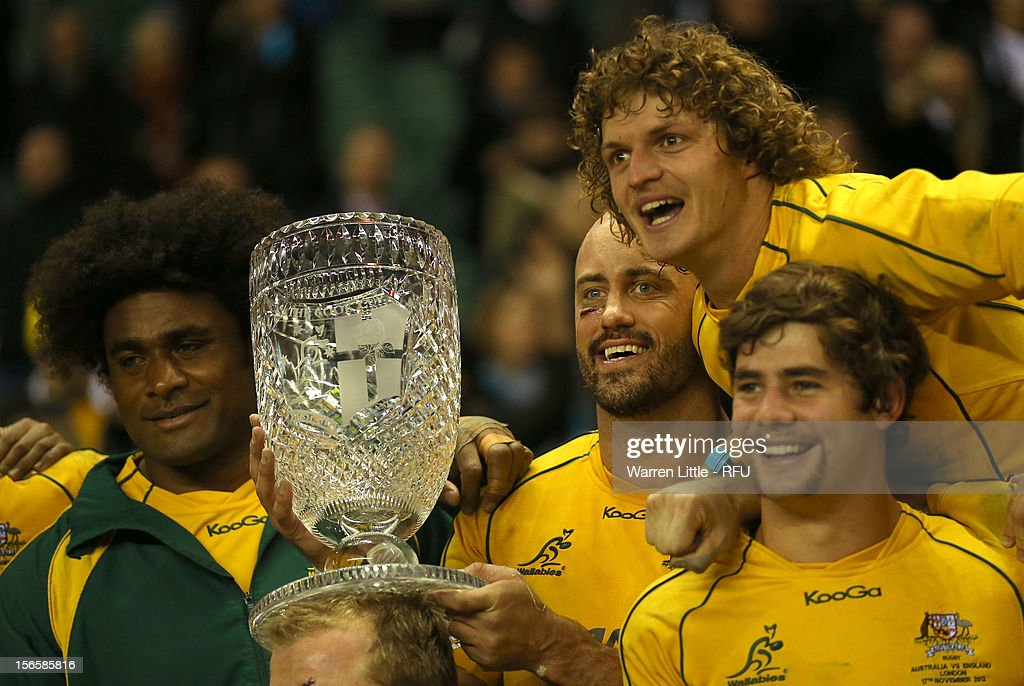 Captain <a gi-track='captionPersonalityLinkClicked' href=/galleries/search?phrase=Nathan+Sharpe&family=editorial&specificpeople=208152 ng-click='$event.stopPropagation()'>Nathan Sharpe</a> (C) of Australia and his team-mates celebrate their victory with the Cook Cup after the QBE International match between England and Australia at Twickenham Stadium on November 17, 2012 in London, England.