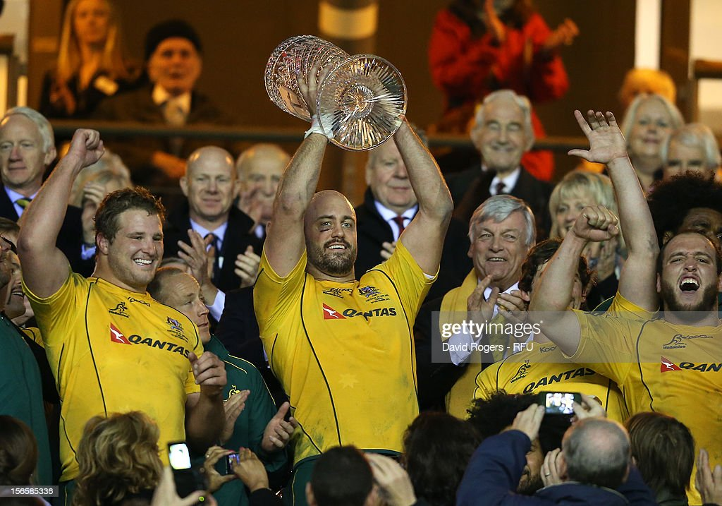 Captain <a gi-track='captionPersonalityLinkClicked' href=/galleries/search?phrase=Nathan+Sharpe&family=editorial&specificpeople=208152 ng-click='$event.stopPropagation()'>Nathan Sharpe</a> (C) of Australia lifts the Cook Cup after the QBE International match between England and Australia at Twickenham Stadium on November 17, 2012 in London, England.