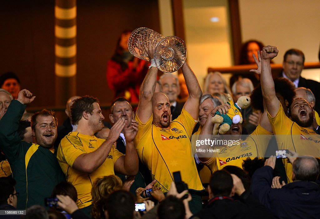 Captain <a gi-track='captionPersonalityLinkClicked' href=/galleries/search?phrase=Nathan+Sharpe&family=editorial&specificpeople=208152 ng-click='$event.stopPropagation()'>Nathan Sharpe</a> (C) of Australia lifts the Cook Cup during the QBE International match between England and Australia at Twickenham Stadium on November 17, 2012 in London, England.
