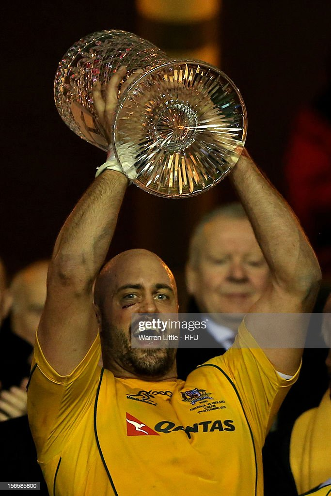 Captain Nathan Sharpe of Australia lifts the Cook Cup during the QBE International match between England and Australia at Twickenham Stadium on November 17, 2012 in London, England.