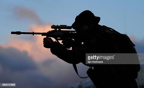 Captain Nick Garrett from Headquarters 7 Brigade looks through the sights of his rifle as part of exercise Talisman Sabre on July 9 2015 in...