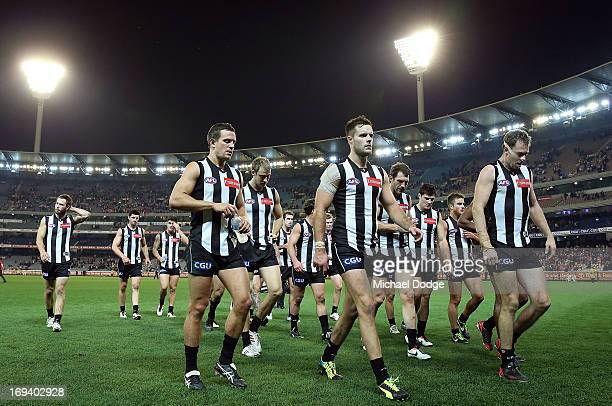Captain Nick Maxwell of the Magpies leads the team off after losing the round nine AFL match between the Collingwood Magpies and the Sydney Swans at...