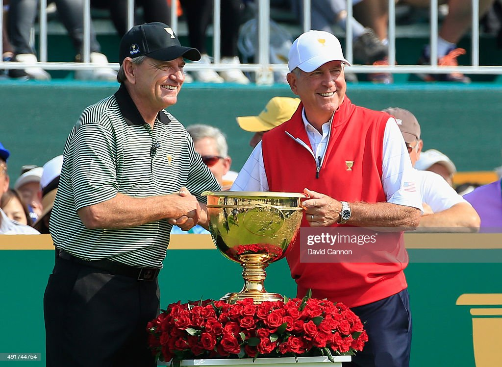 Captain Nick Price of the International Team (L) shakes hands on the first tee with Captain Jay Haas of the United States Team during the Thursday foursomes matches at The Presidents Cup at Jack Nicklaus Golf Club Korea on October 8, 2015 in Songdo IBD, Incheon City, South Korea