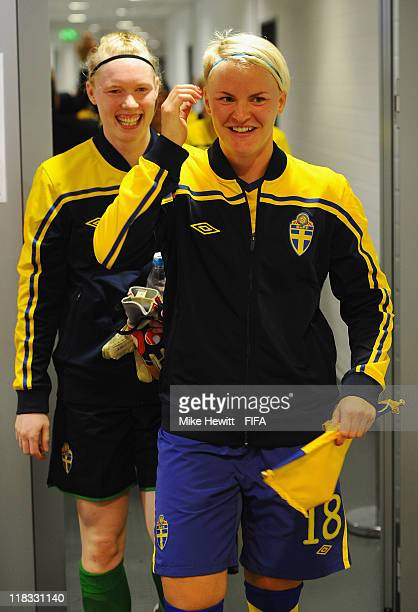 Captain Nilla Fischer and goalkeeper Hedvig Lindahl of Sweden walk along the tunnel during the FIFA Women's World Cup 2011 Group C match between...