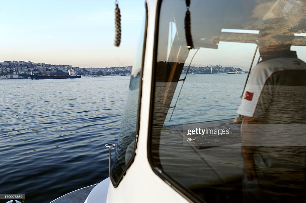 Captain of a ferry navigates on June 6, 2013 on the Bosphorus in Istanbul. Prime Minister Recep Tayyip Erdogan was due back in Turkey today after a trip abroad, with thousands of angry demonstrators calling for his resignation as protests entered a seventh day.