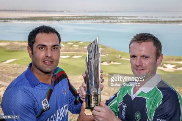 Captain of Afghanistan Mohammad Nabi and Captain of Ireland William Porterfield pose with the Champions trophy at the Radisson Blu hotel Abu Dhabi...