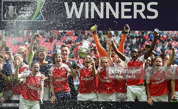 Captain of Arsenal Ladies Alex Scott lifts the trophy after winning the SSE Women's FA Cup Final between Arsenal Ladies and Chelsea Ladies at Wembley...