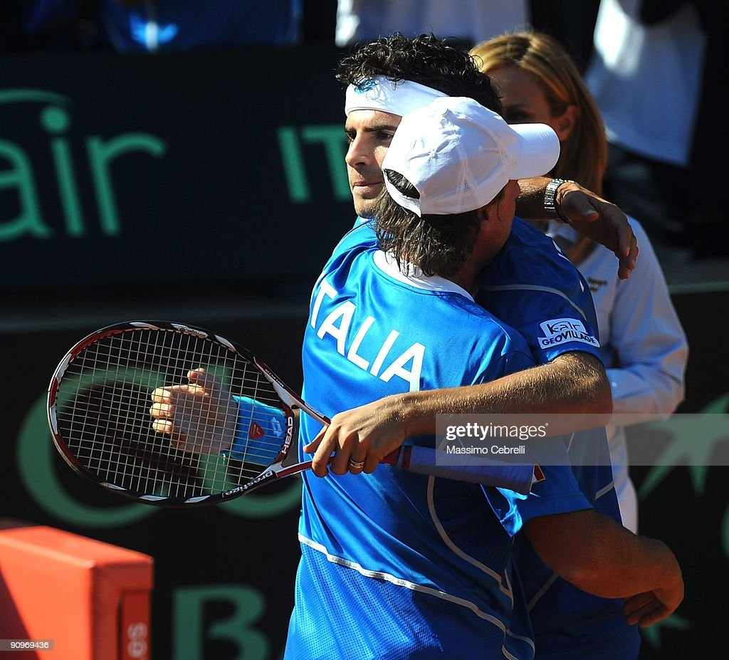 Captain of Corrado Barazzutti (L) of Italy congratultes Simone Bolelli after the Davis Cup doubles tennis match between Italy and Switzerland at Sports Center Valletta Cambiaso on September 19, 2009 in Genoa, Italy.