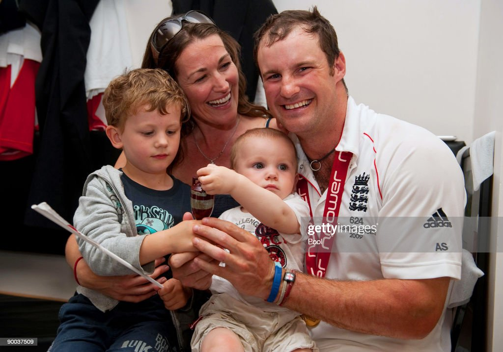 Captain of England Andrew Strauss celebrates with the Ashes Urn in the changing room with his wife Ruth and sons Samuel (L) and Luca following the fifth npower Test Match at the Oval on august 23, 2009 in London, England.