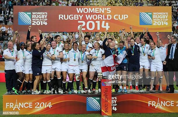 Captain of England Katy McLean lifts the trophy with teammates to celebrate their victory in the IRB Women's Rugby World Cup 2014 Final between...