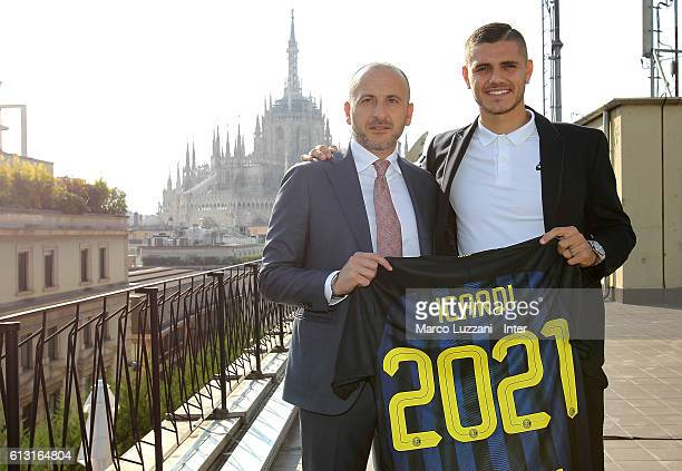 Captain of FC Internazionale Milano Mauro Icardi and Sportif Director of FC Internazionale Milano Piero Ausilio pose with the club shirt after...