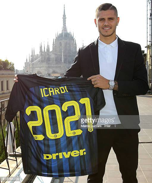 Captain of FC Internazionale Milano Mauro Icardi poses with the club shirt after signing the renewal of his contract on October 7 2016 in Milan Italy