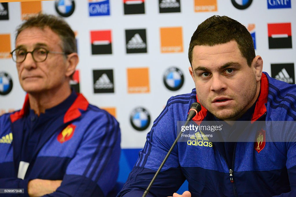 Captain of France team Guilhem Guirado (R) under the gaze of France head coach Guy Noves (L) during a press conference at National Center of Rugby in Marcoussis, on February 18, 2016 in Paris, France. The press conference will announce the team members selected for France's Six Nations rugby match against Ireland in Paris on February 13.