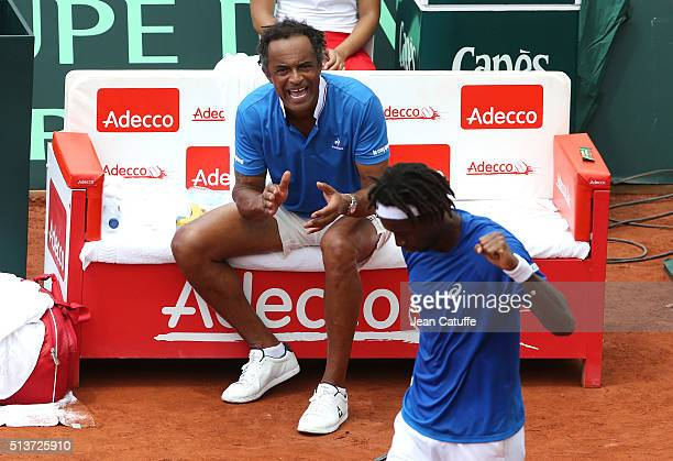 Captain of France Yannick Noah cheers for Gael Monfils of France on day 1 of the Davis Cup World Group first round tie between France and Canada at...