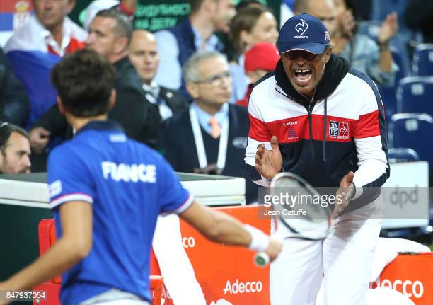 Captain of France Yannick Noah supports his players during the doubles match against Serbia on day two of the Davis Cup World Group tie between...