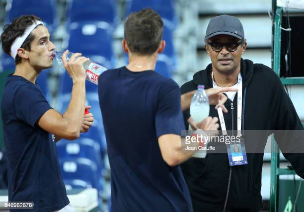 Captain of France Yannick Noah with doubles partners PierreHugues Herbert and Nicolas Mahut during practice on the eve of the Davis Cup World Group...