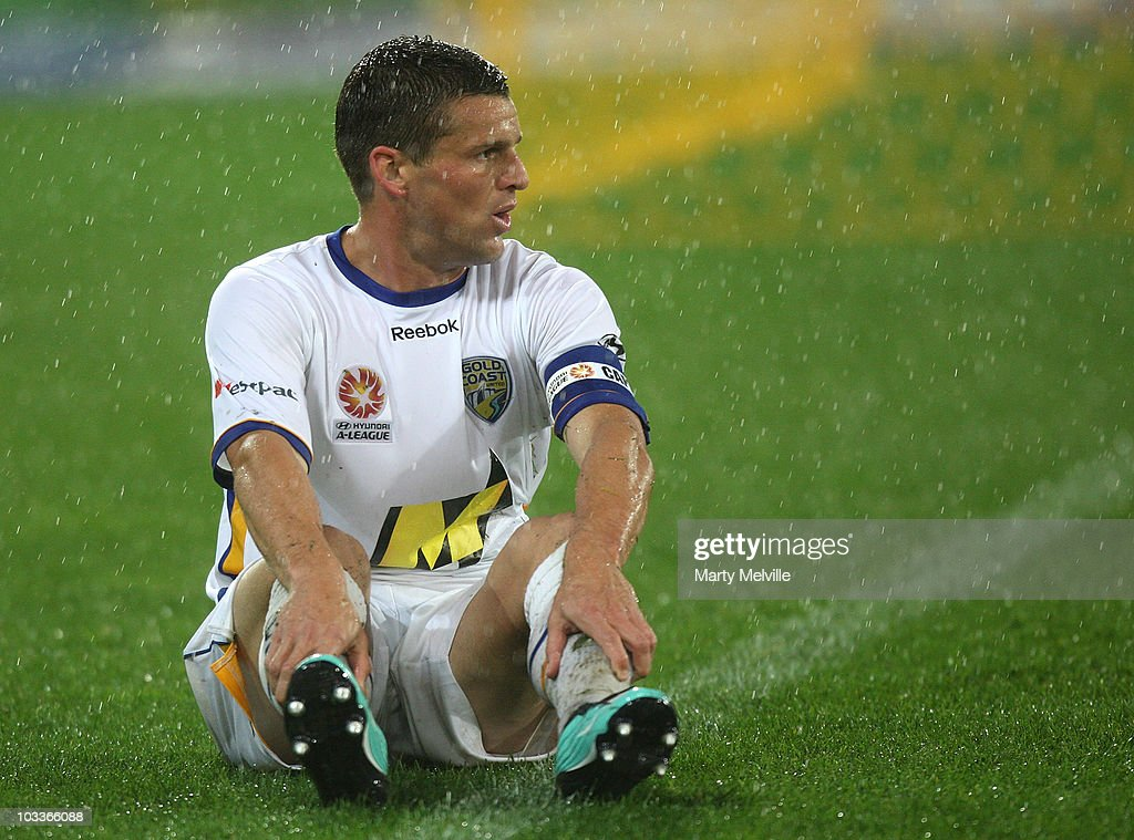 Captain of Gold Coast Jason Culina sits dejected after a missing a goal during the round two A-League match between the Wellington Phoenix and Gold Coast United at Westpac Stadium on August 13, 2010 in Wellington, New Zealand.