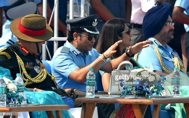 Captain of Indian Air Force Sachin Tendulkar gestures next to Air Chief Marshal Birender Singh Dhanoa during the 85th Air Force Day parade at Hindon...