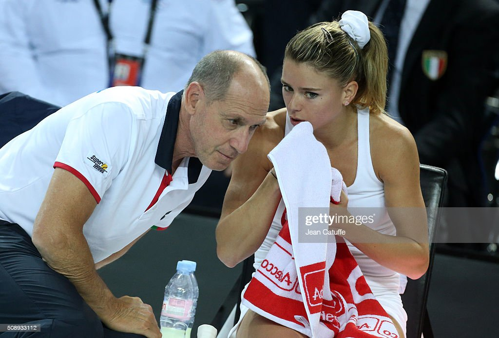 Captain of Italy Corrado Barazzutti talks to <a gi-track='captionPersonalityLinkClicked' href=/galleries/search?phrase=Camila+Giorgi&family=editorial&specificpeople=7865503 ng-click='$event.stopPropagation()'>Camila Giorgi</a> during day 2 of the Fed Cup World Group tie between France and Italy at Palais des Sports on February 7, 2016 in Marseille, France.