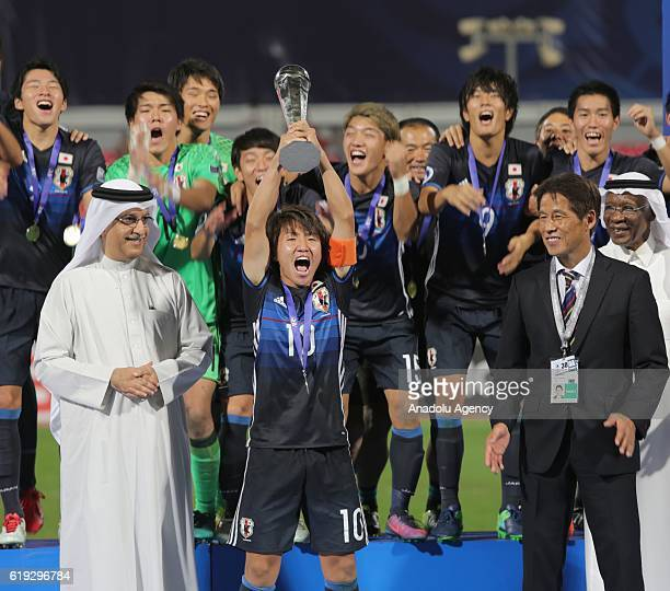 Captain of Japan Sakai Daisuke raise the cup at the end of the Asian Under19 Championship football match between Japan and Saudi Arabia at the...