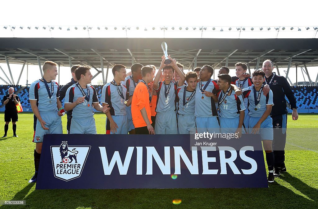 Captain of King Edwards's School Witley, Yahoo Ho celebrates with his team during the Premier League under 16 Small Schools' Cup final match between King Edwards's School Witley and Blacon High School at the Academy Training Ground on May 04, 2016 in Manchester, England.