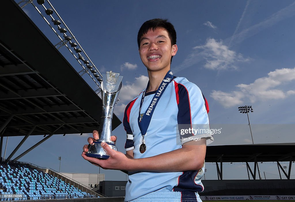 Captain of King Edwards's School Witley, Yahoo Ho poses with the trophy during the Premier League under 16 Small Schools' Cup final match between King Edwards's School Witley and Blacon High School at the Academy Training Ground on May 04, 2016 in Manchester, England.