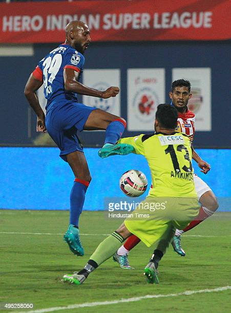 Captain of Mumbai City FC Anelka trying to go past of Atletico de Kolkata goal keeper Amrinder Singh during Indian Super League match at DY Patil...