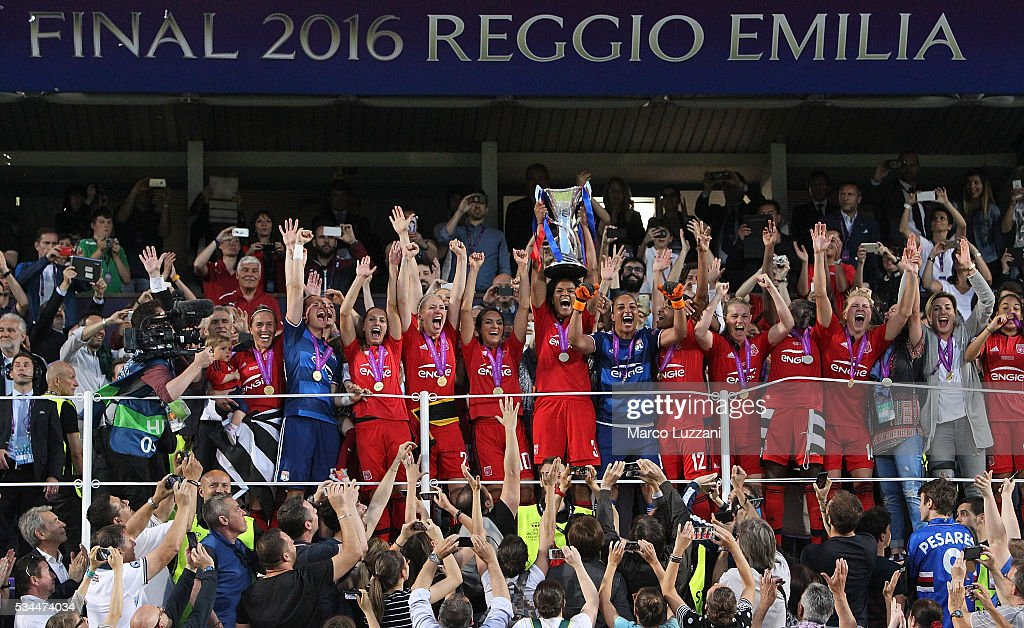 Captain of Olympique Lyonnais Wendie Renard lifts the trophy following the the UEFA Women's Champions League Final VfL Wolfsburg and Olympique Lyonnais between at Mapei Stadium - Citta' del Tricolore on May 26, 2016 in Reggio nell'Emilia, Italy.