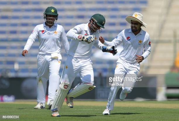 Captain of Pakistan Sarfraz Ahmed celebrates taking the wicket of Kusal Mendis of Sri Lanka during Day One of the First Test between Pakistan and Sri...