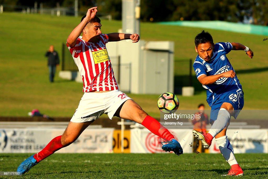 Captain of Parramatta FC Hamish Galbraith tackles Yu Kuboki of Olympic FC during the NSW NPL Men's match between Sydney Olympic FC and Parramatta FC on June 18, 2017 in Sydney, Australia.