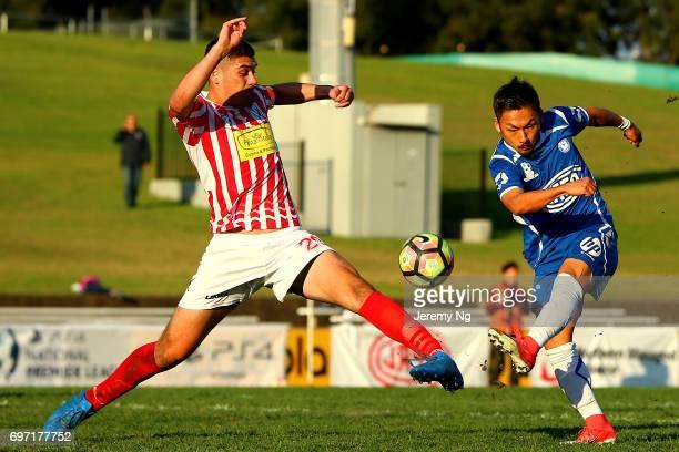 Captain of Parramatta FC Hamish Galbraith tackles Yu Kuboki of Olympic FC during the NSW NPL Men's match between Sydney Olympic FC and Parramatta FC...