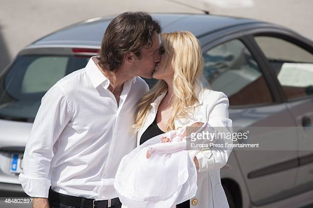 Captain of Spain's Davis Cup Carlos Moya and his wife actress Carolina Cerezuela with their newborn daughter Daniela Moya on April 14 2014 in Madrid...