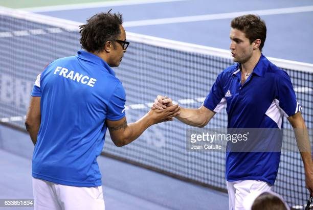 Captain of Team France Yannick Noah greets Gilles Simon of France following his victory against Yoshihito Nishioka of Japan on day 1 of the Davis Cup...