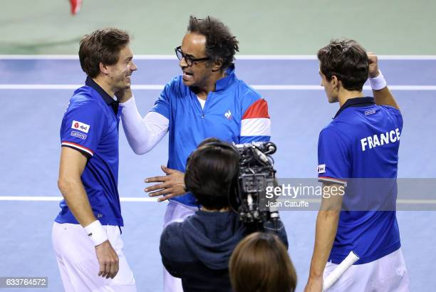 Captain of Team France Yannick Noah greets Nicolas Mahut and PierreHughes Herbert of France after their win in the doubles match on day 2 of the...