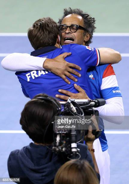 Captain of Team France Yannick Noah greets Nicolas Mahut of France after his win with PierreHughes Herbert of France in the doubles match on day 2 of...