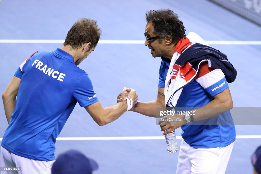Captain of Team France Yannick Noah (right) greets Richard Gasquet of France following his victory against Daniel Taro of Japan on day 1 of the Davis Cup World Group first round tie between Japan and France at Ariake Coliseum (Ariake Colosseum) on February 3, 2017 in Tokyo, Japan.