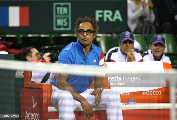 Captain of Team France Yannick Noah looks on along coaches Cedric Pioline and Loic Courteau behind him on day 1 of the Davis Cup World Group first...