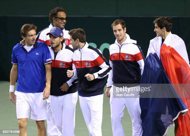 Captain of Team France Yannick Noah Nicolas Mahut Lucas Pouille Gilles Simon Richard Gasquet PierreHughes Herbert of France celebrate winning the...