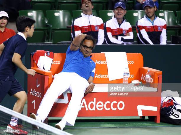 Captain of Team France Yannick Noah while coaches Cedric Pioline Loic Courteau and Lucas Pouille look on behind him on day 1 of the Davis Cup World...