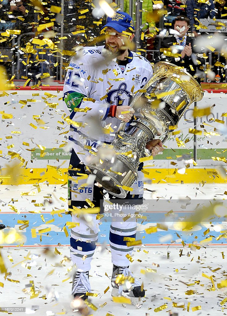 captain of team Yury Babenko celebrates with the trophy after Dinamo Moscow defeats Traktor Chelyabinsk at the final play-off game during the KHL Championship 2012/2013 on April 18, 2013 at the Arena Traktor in Chelyabinsk, Russia.