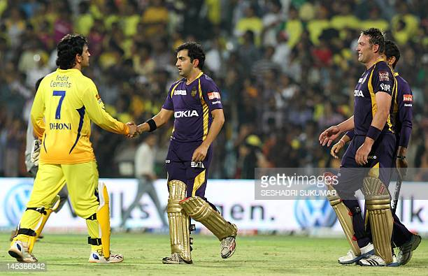 Captain of the Chennai Super Kings Mahendra Singh Dhoni shakes hands with Kolkatta Knight Riders captain Gautam Gambhir at the end of the IPL...