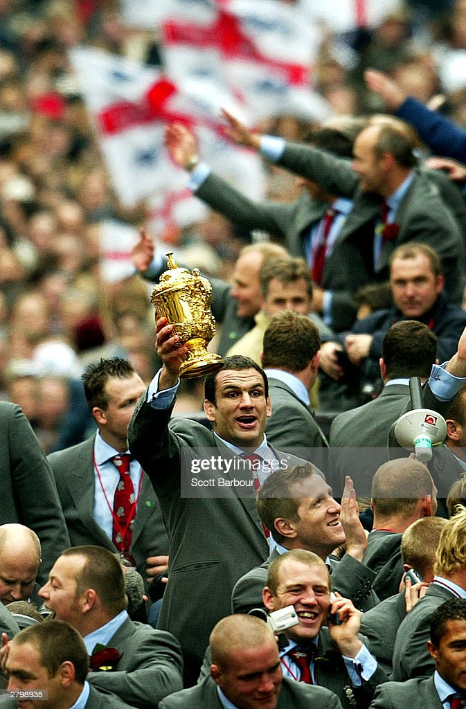 Captain of the England rugby team, Martin Johnson, holds the William Webb Ellis trophy aloft during the England Rugby World Cup team victory parade December 8, 2003 in London. Up to half a million supporters are expected to flock to central London on Monday for the procession after England beat Australia 20-17 in the final on November 22.