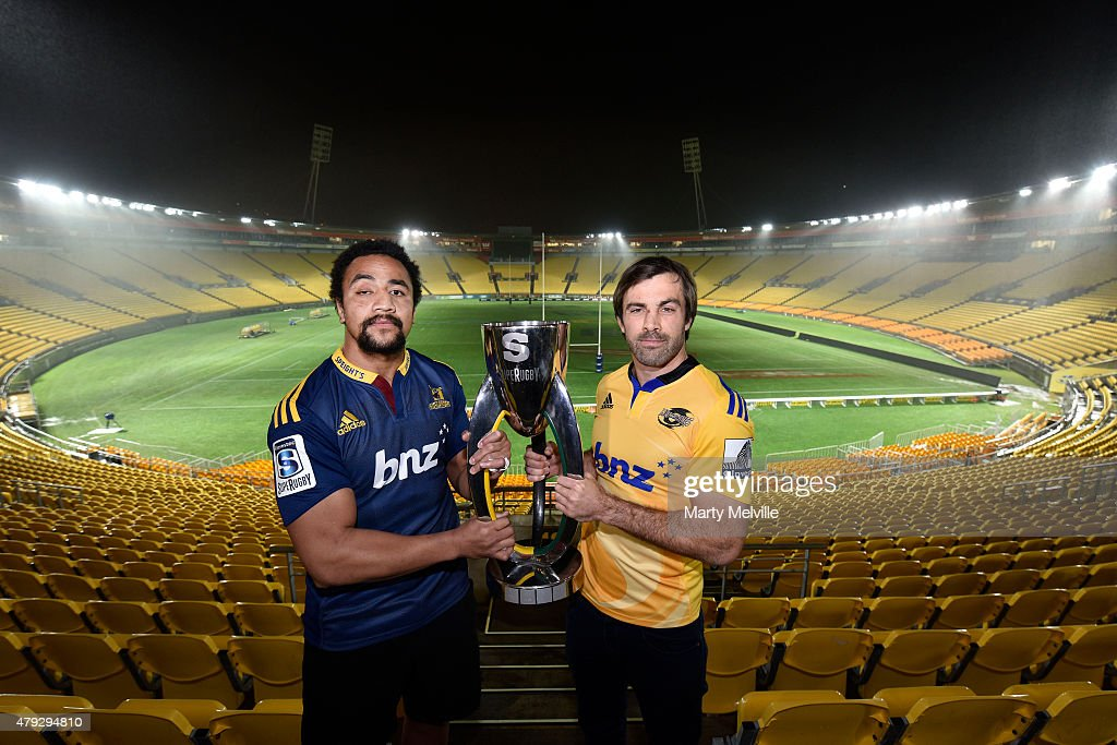 Captain of the Hurricanes Conrad Smith holds the Super 15 trophy with captain of the Highlanders Nasi Manu during the Super Rugby Final media...